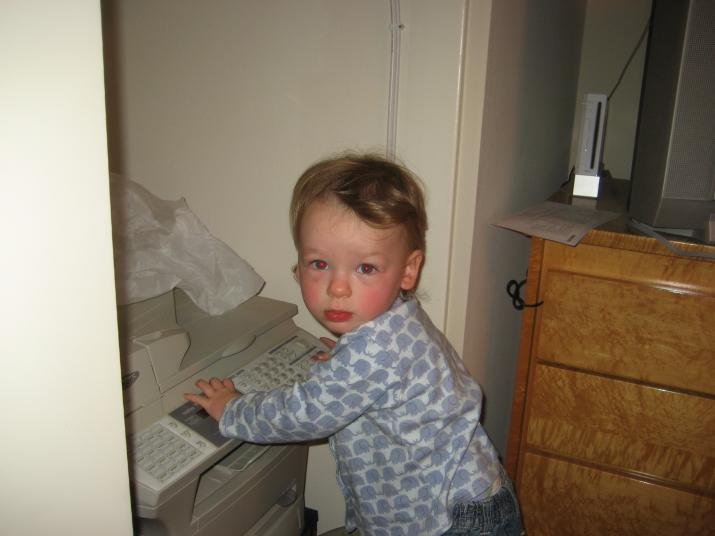 I'm good at pushing buttons.  And delivering papers that mommy and daddy have just printed.